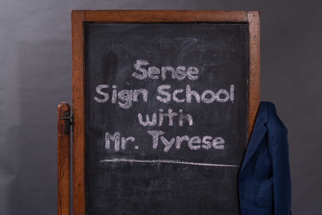 Behind the scenes shot of Tyrese filming sign language lessons