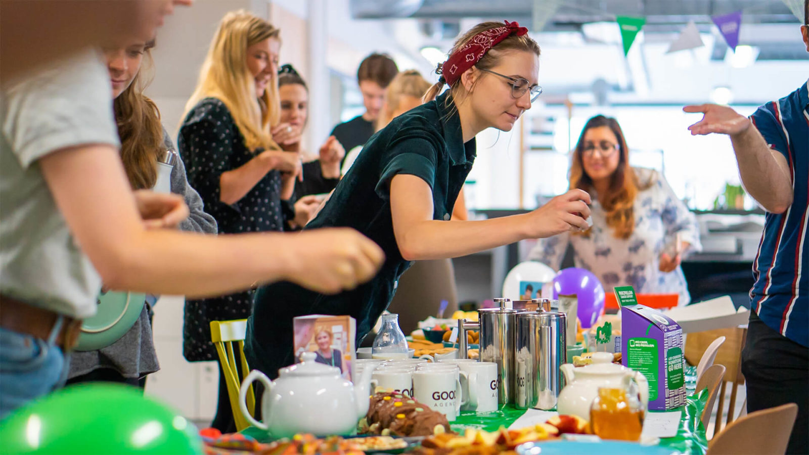 Agency staff participating in coffee morning